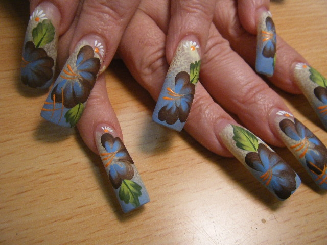 Exhibit Fine Floral Details on Large Nails