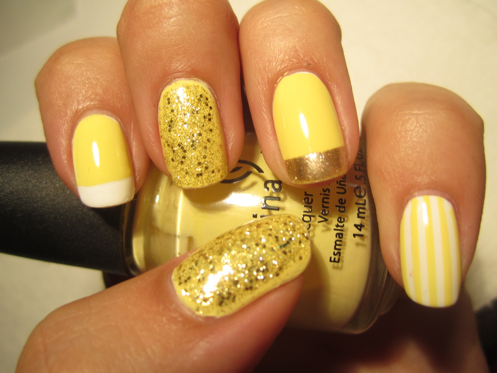 Trendy and Glittering Yellow Nails